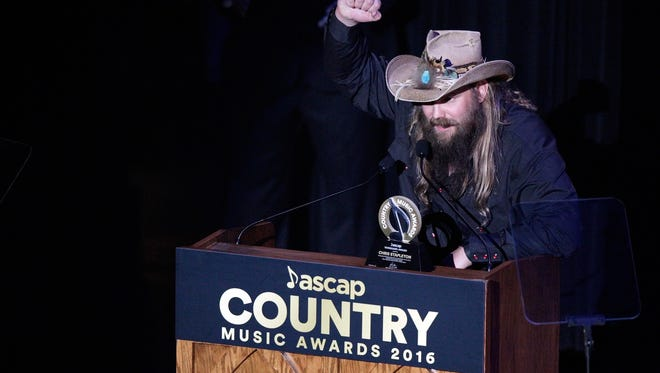 Chris Stapleton speaks after receiving The Vanguard Award at the 54th Annual ASCAP Country Music Awards at the Ryman Auditorium on Monday, Oct. 31, 2016, in Nashville, Tenn. (Photo by Wade Payne/Invision/AP)
