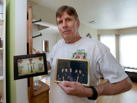 Robert Reeg shows off mementos from his service with