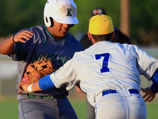 King's Jacob Garza gets tagged out at third base by
