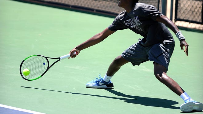 Pranac Kumar, from Plano, runs down a ball for a return during his match against Kevin Zhu, from Pearland, in the boys' 18 singles championship match of the USTA Texas Grand Slam on Friday, June 16, 2017, at Abilene Christian Unversity's Eager Tennis Center.