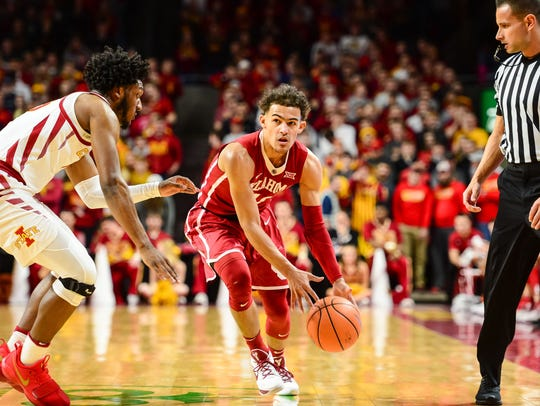 Oklahoma Sooners guard Trae Young (11) is defended