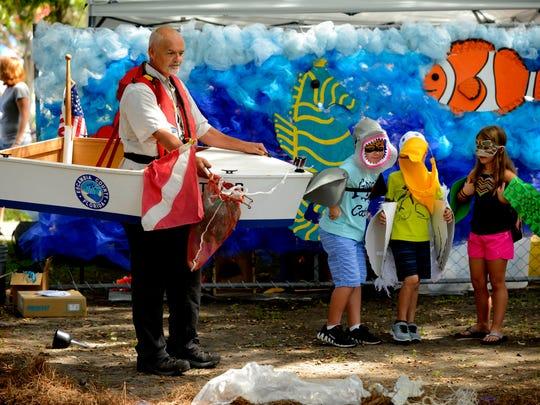 Robert Turpin, Manager, Marine Resources Division at Escambia County Board of County Commisioners, puts on a skit about what happens to wild life when there is trash in the waterways Saturday during the Pensacola Seafood Festival at Seville Square.