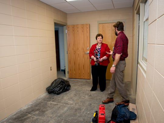 Southern Door Superintendent Patti Vickman talks with Matt Luders, business health and wellness executive for Ministry Door County Medical Center, discuss the ongoing renovations of the upcoming Southern Door Community Clinic. The clinic is expected to open Feb. 15.