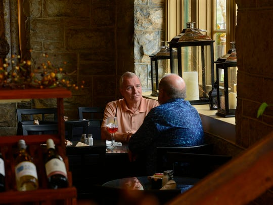Pete Van Berkum enjoys brunch with a friend Sunday at The Vineyard in Old Sacred Heart Hospital in East Hill.