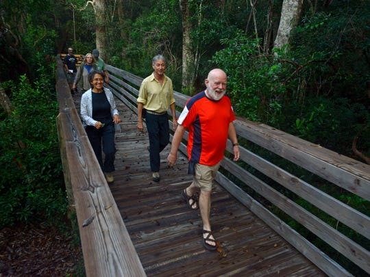Western Gate Chapter of the Florida Trail Association members walk through the Jones Swamp Nature Preserve Sunday morning.