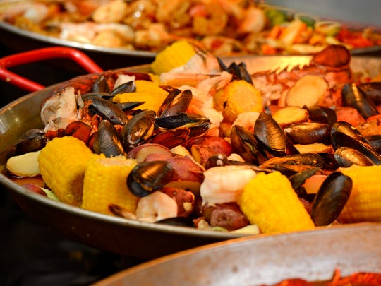 Seafood simmers during the 39th annual Pensacola Seafood Festival in Seville Square.