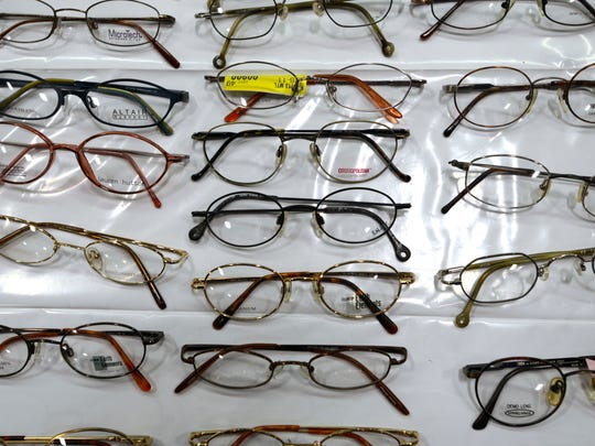 New frames await patints Saturday at the Remote Area Medical clinic at Milton High School. Patients received free medical, dental and vision services as well as free hair cuts.