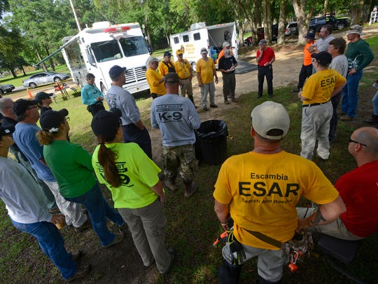 Search and rescue teams gather at Olive Baptist Church for the morning briefing Sunday, June 4, 2017, as the search for Naomi Jones continues for the fourth day.