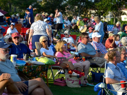 The crowd listens to Not Quite Fab: A Tribute to the Beatles, perform for the crowd Sunday, August 20, 2017 during the 2017 Blues Angel Music Blues on the Bay Summer Concert Series at Community Maritime Park.