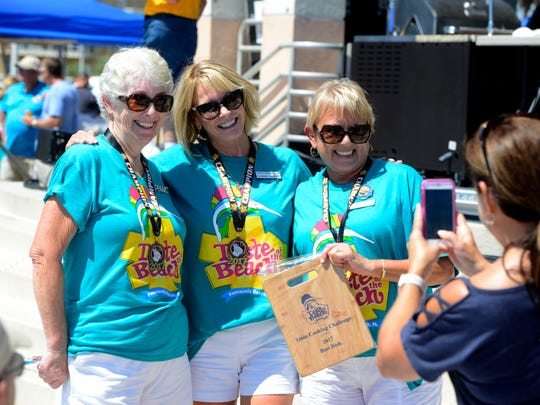 Members of the Pensacola Beach Women's Club celebrate after winning the team cooking competition Sept. 16, 2017, during Taste of the Beach at Pensacola Beach.