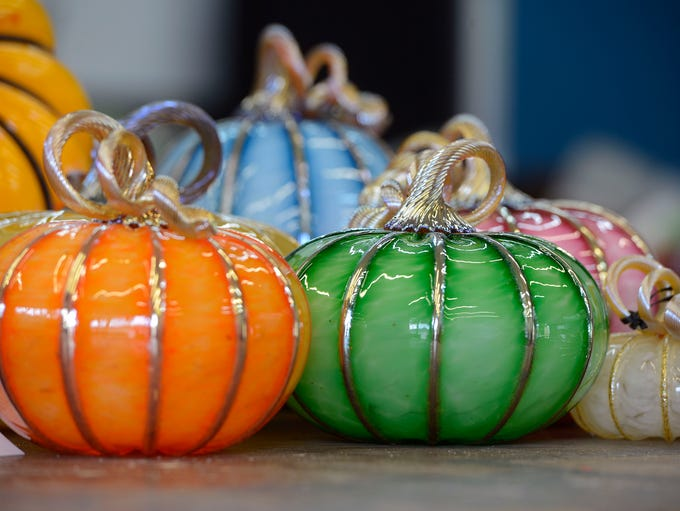 Glass pumpkins made at Strong Street Studios for their
