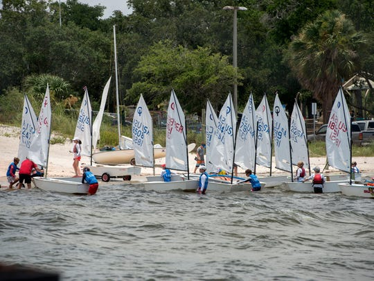 Sailors bring their boats back to the Pensacola Yacht Club during the Junior Olympic Sailing Festival on June 30, 2018. More than 300 hundred young sailors will be welcomed to Pensacola on Saturday during an opening ceremony for three national championship events this coming week organized by Pensacola Yacht Club and the US Optimist Dinghy Association.
