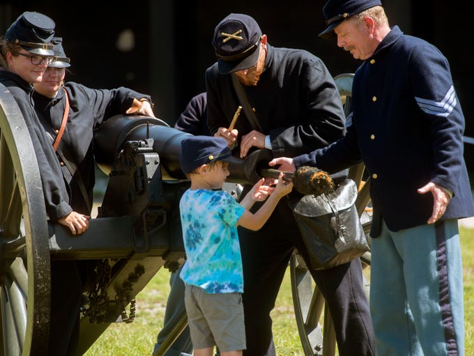 Civil War reenactors show Connor Post,5, how to load