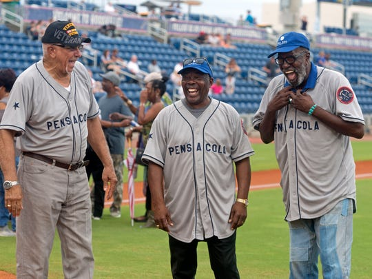 Members of the 1955 Pensacola Jaycees Little League team chat Aug. 18 at Blue Wahoos Stadium in Pensacola.