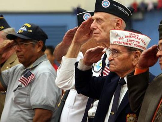 El Paso military veterans, including Manuel Rivas, second from right, saluted during presentation of the colors at the MacArthur school Veteran's Day ceremony in this file photo from 2008,