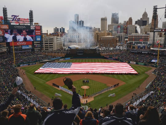 Fans stand during the opening ceremony of Opening Day