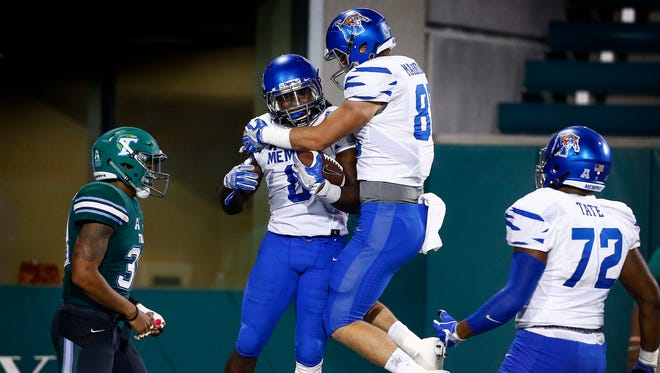 University of Memphis running back Darrell Henderson (left midde) celebrates a with teammate Daniel Montiel (right middle) after completing a 45 yard touchdown run against the Tulane University defense during fourth quarter action at Yulman Stadium in New Orleans.