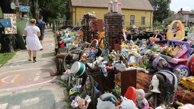 """Visitors explore Tyree Guyton's Heidelberg Project Sunday, Aug. 14, 2016 on  in Detroit. Many people learned today through that Guyton  is dismantling his project  and it will not happen right away. It will evolve it into an """"arts-infused"""" community instead of it just being driven by him only. Regina H. Boone/Detroit Free Press"""