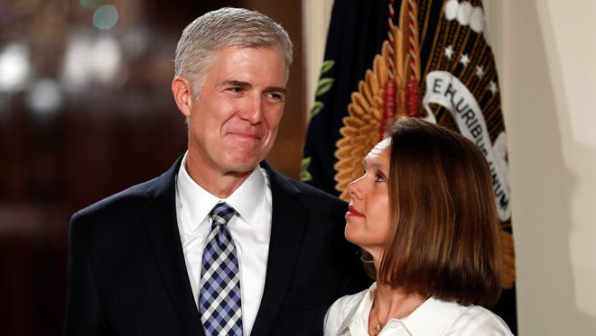 Judge Neil Gorsuch stands with his wife Louise as President Donald Trump announces him as his choice for the Supreme Court during a televised event in the East Room on the White House Tuesday.