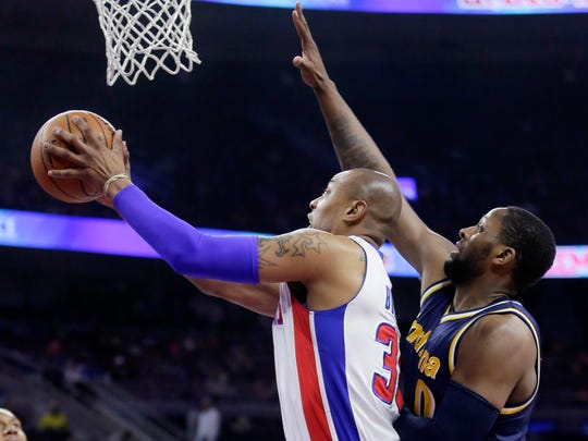 Detroit Pistons' Caron Butler, left, goes to the basket against Indiana Pacers' C.J. Miles (0) during the first half of an NBA basketball game Friday, April 10, 2015, in Auburn Hills, Mich. (AP Photo/Duane Burleson)
