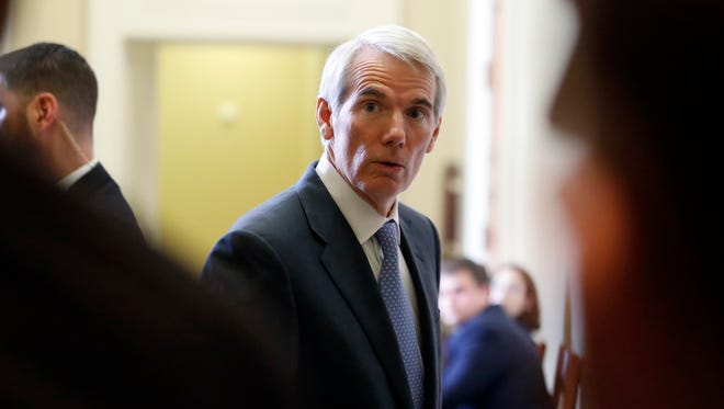 Sen. Rob Portman, R-Ohio, listens to a reporter's question as he enters a caucus luncheon on Capitol Hill. Nov. 16, 2016.