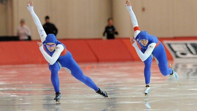 Sugar Todd (left) and Brittany Bowe compete in the U.S. Long Track Speedskating Championships in 2015 at the Pettit National Ice Center.