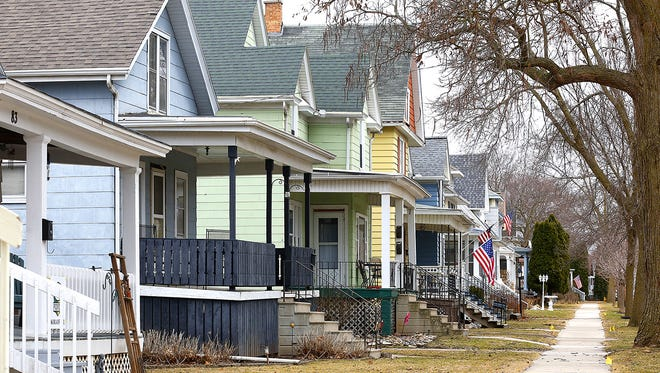 Houses with private lead pipe service lines on Fifth Street between Marr and Ellis Streets in Fond du Lac are among 148 homes in the city that must replace their pipes this year due to a mandatory program.