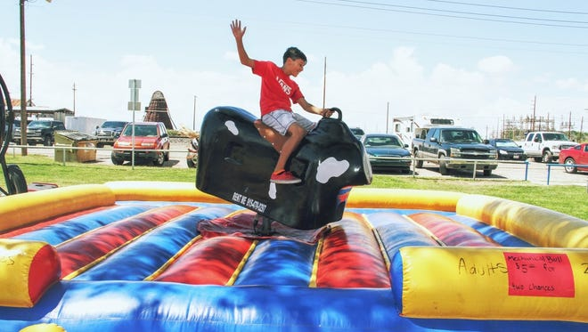 In this 2016 file photo, Ashton Mason gets a bull ride at the 26th annual Cottonwood Festival at Alameda Park.