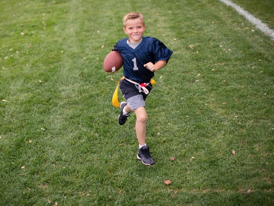 Young Boy Flag Football Player Scores Touchdown