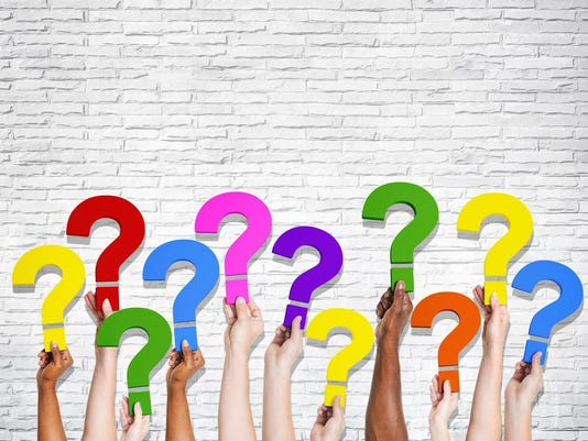 Multiethnic Group of Human Hands Holding Question Marks