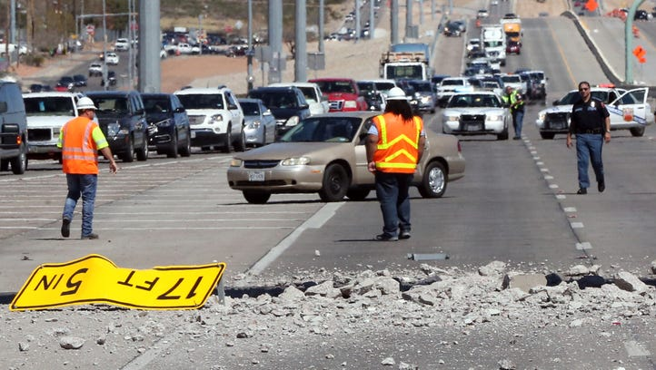Excavator on trailer hits pedestrian bridge on US 54; portion collapses
