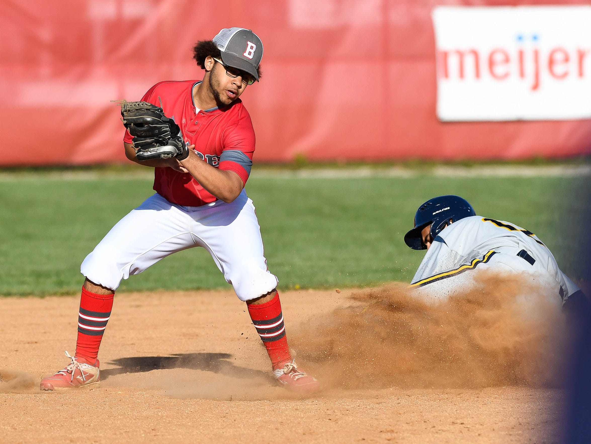 Castle's Noah Gilbert (12) beats the tag from Bosse's Brennen Tompkins (3) in the Knights' victory on Thursday.