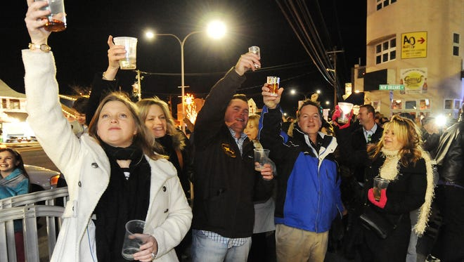 """Dewey Beach brought in 2014 with a dropping of a """"Skimboarding Figure"""" from the roof of the Surfrider Apts. at New Orleans St. and Coastal Highway to the delight of a crowd of about 300 on a cold blustery night New Years Eve, with the event sponsored by the Dewey Beach Business Partnership. Special to the Daily Times / CHUCK SNYDER"""
