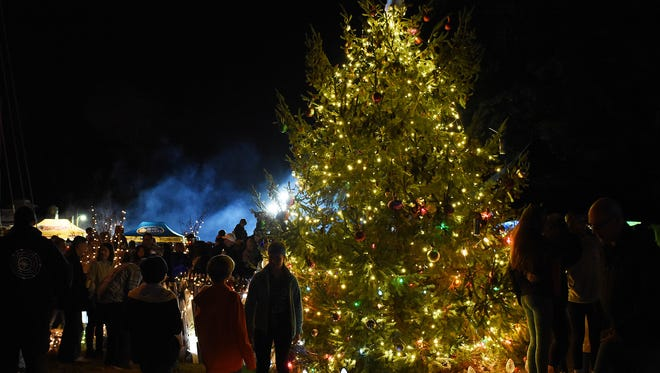 A large crowd was on hand as Dewey Beach brought in the Christmas Season with it's Annual Christmas Tree Lighting Ceremony held Downtown near Coastal Highway complete with a sing along of Christmas Carols, food by local restaurants and an appearance by Santa Claus who rode a Fire Truck to greet the kids.Special to the Daily Times/ CHUCK SNYDER