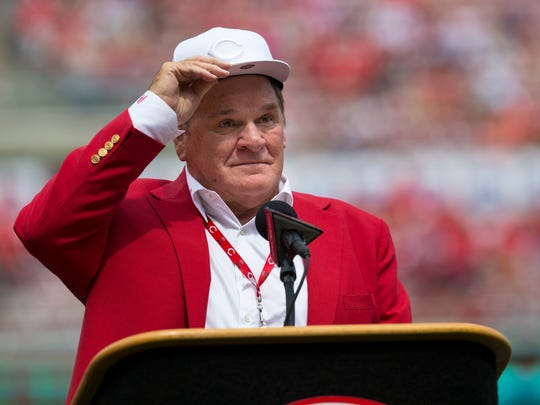 An emotional Cincinnati Reds hall of famer Pete Rose adjusts his cap as he takes the microphone during a pregame ceremony for the unveiling of Pete Rose's bronze statue being installed outside the stadium before the MLB National League game between the Cincinnati Reds and the Los Angeles Dodgers at Great American Ball Park in downtown Cincinnati on Saturday, June 17, 2017.