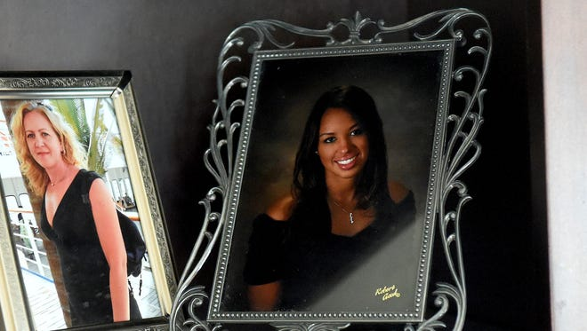 "A portrait of Mackenzie Gray from her senior year of high school sits on a shelf next to a picture of her mother. Gray was on the same career path as her mom. She became an LPN in 2016 and was thinking about going back to school to become a registered nurse. ""I've always thought that she never listened to much of what I said,"" Shannon said recently, thinking about the last few years, ""but here lately I think that maybe she did."""