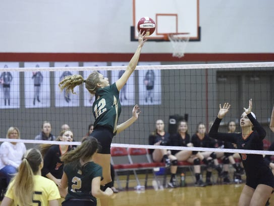 Vestal's Lauren Hess extends for a tip Wednesday during