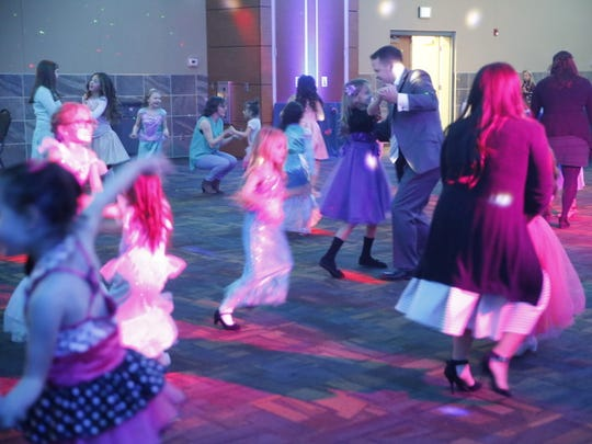 The annual Mom Prom at the Farmington Civic Center on Friday attracted dozens of families.