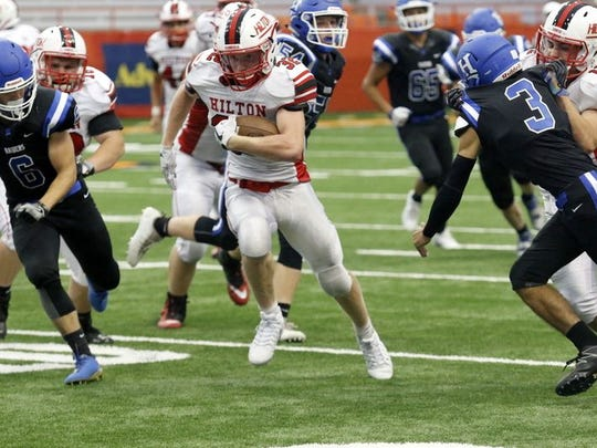 Hilton's Max Chamberlain runs for daylight against Horseheads at the Carrier Dome on Sunday, Sept. 3, 2017. Chamberlain rushed for 346 yards and a school-record six touchdowns in a 48-30 win.