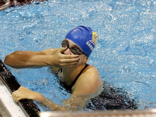 Maine-Endwell's Laura Sarkisian reacts after winning the 200-yard freestyle in 2:00.15 on Sept. 30 at the Dr. Jack Thomas Girls Swimming and Diving Invitational at Ernie Davis Academy.