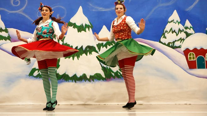 Amy Fenicke, left, and Hollie Wall danced during the Elf Show, part of Christmas at the Galt House. Nov. 19, 2015.