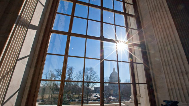 FILE - In this Jan. 27, 2014 file photo, the Capitol is seen from the Russell Senate Office Building on Capitol Hill in Washington. Lawmakers return to Washington on Tuesday, Sept. 6, 2016 for an abbreviated election-season session in which they will likely do what they do best: the bare minimum. In this case, that means preventing the government from shutting down and finally providing money for the government's battle against the mosquito-borne Zika virus.  (AP Photo/J. Scott Applewhite, File)