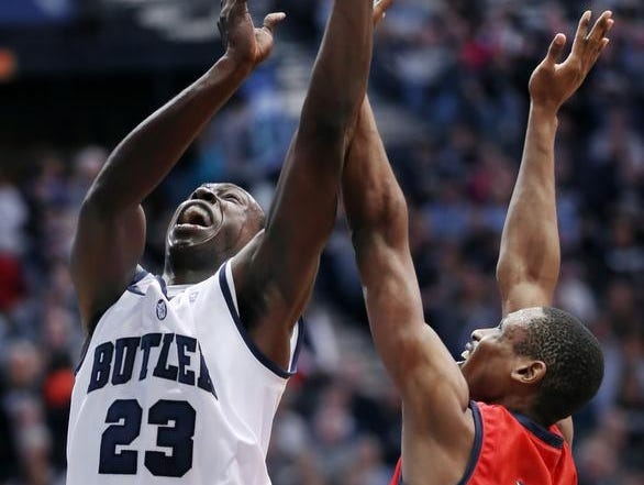 Butler's Khyle Marshall gets pressure from NJIT's Terrence Smith while going to the hoop in the first half of their game held at Butler University on Saturday, December 28, 2013. Butler beat NJIT 66-48.
