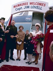 Astronaut Jim Lovell visits his hometown of Milwaukee on Feb. 23, 1966, shortly after spending two weeks in space on Gemini 7. Beside him are three of his four children and his wife, Marilyn, whom he met at Juneau High School.