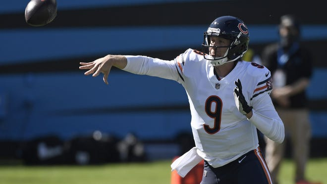 Chicago Bears quarterback Nick Foles (9) passes against the Carolina Panthers during the first half of a Sunday' sgame in Charlotte, N.C.