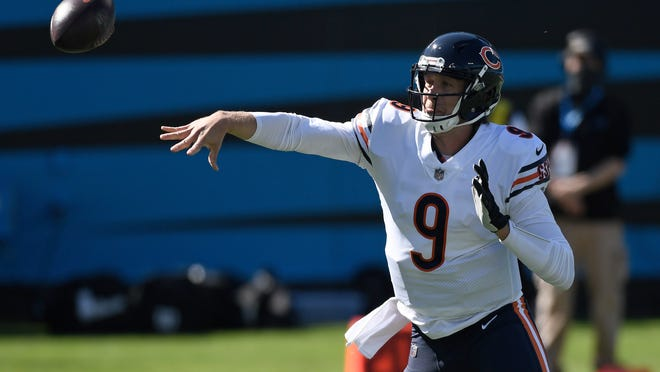 Chicago Bears quarterback Nick Foles (9) passes against the Carolina Panthers during the first half Sunday in Charlotte, N.C.