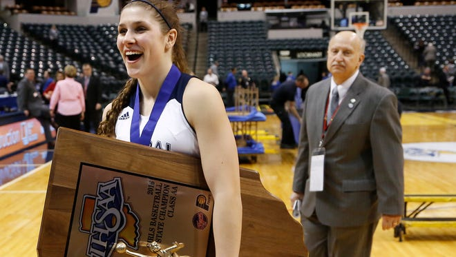 Cameron Onken smiles as she walks off the Bankers Life Fieldhouse court Class 2A State Champion trophy in hand after Central Catholic defeated Covenant Christian 56-43 in the Class 2A State Finals Saturday, February 27, 2016, at Bankers Life Fieldhouse in Indianapolis. Onken also won the Mental Attitude Award for Class 2A basketball. She won the Mental Attitude Award for Class A volleyball this past fall.