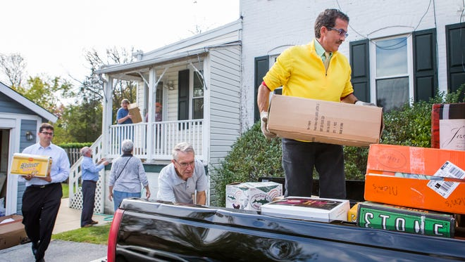 Volunteers load up donations to be shipped to Syrian refugees in Turkey at St. Joseph on the Brandywine Catholic Church in Greenville on Sunday afternoon.