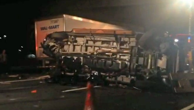 In this image from video, a limousine bus carrying Tracy Morgan and six other people lies on it's side June 7, 2014, on the New Jersey Turnpike, after a crash severely injured Morgan and killed another comedian.