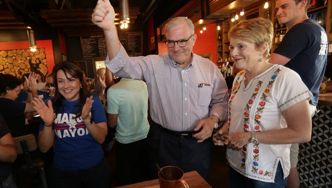 Dee Margo, who will be El Paso's new mayor, gives a thumbs-up seconds after seeing early voting results Saturday at his election night watch party at Toro Burger in West El Paso. Margo is flanked by his wife, Adair Margo, right, and campaign manager Olivia Zepeda.